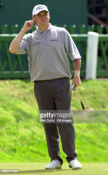 Open champion Paul Lawrie appears puzzled as he checks out the 18th green after a brief practice session at St Andrews on the final practice day of...