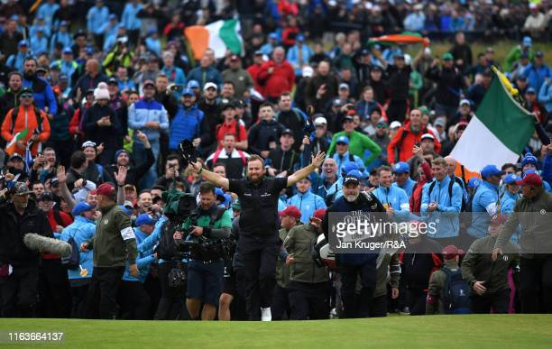 Open Champion Shane Lowry of Ireland celebrates walking up the 18th during the final round of the 148th Open Championship held on the Dunluce Links...