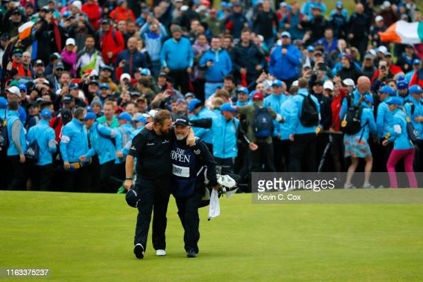 Open Champion Shane Lowry of Ireland celebrates with caddie Bo Martin on the 18th green during the final round of the 148th Open Championship held on...