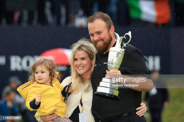 Open Champion Shane Lowry of Ireland celebrates with the Claret Jug wife Wendy and daughter Iris on the 18th green during the final round of the...