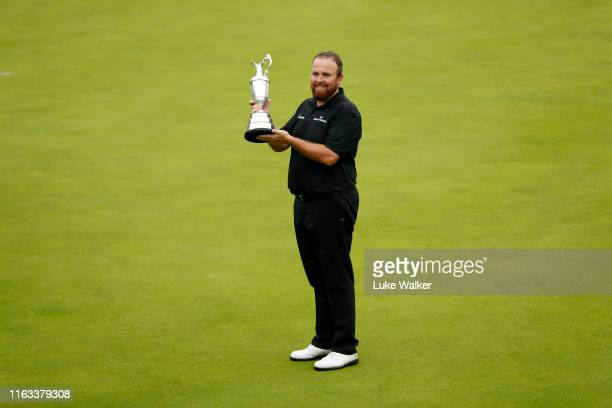 Open Champion Shane Lowry of Ireland celebrates with the Claret Jug on the 18th green during the final round of the 148th Open Championship held on...