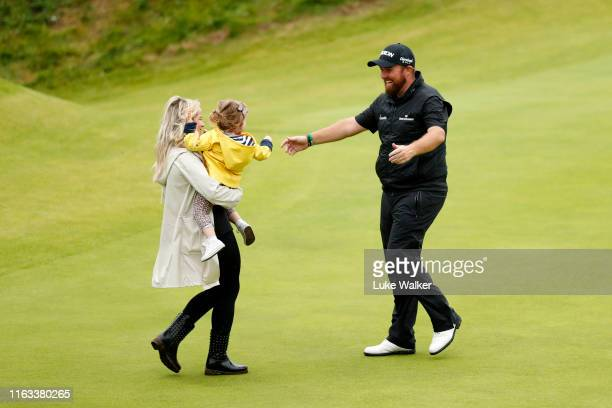 Open Champion Shane Lowry of Ireland celebrates with wife Wendy and daughter Iris on the 18th green during the final round of the 148th Open...