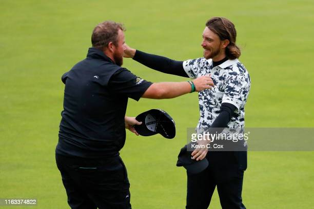 Open Champion Shane Lowry of Ireland hugs Tommy Fleetwood of England on the 18th green during the final round of the 148th Open Championship held on...
