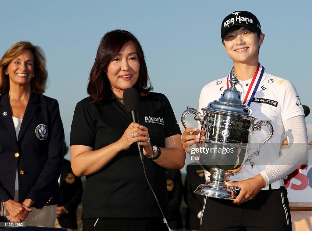 U.S. Open champion Sung Hyun Park of Korea addresses the fans with her interpreter after the final round of the U.S. Women's Open on July 16, 2017 at Trump National Golf Club in Bedminster, New Jersey.