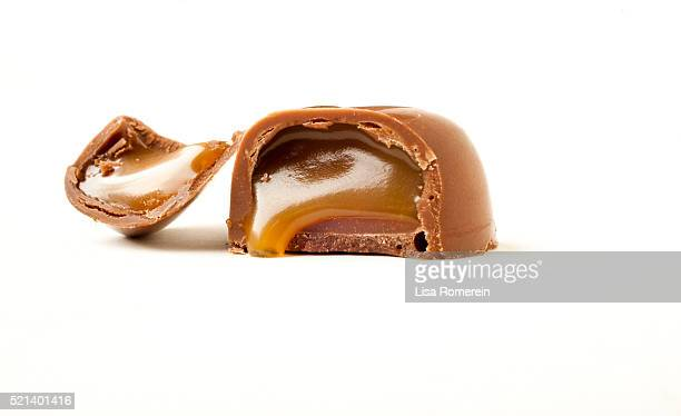 Open chocolate candy with caramel dripping out