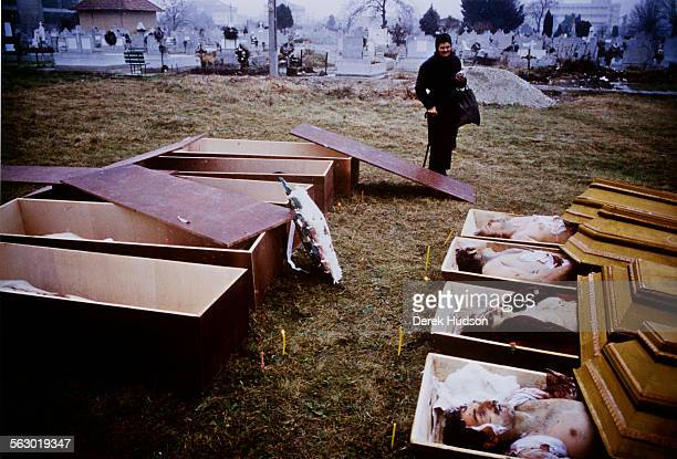 Open coffins in the cemetery in Timisoara in western Romania shortly after the mass street protests at the start of the Romanian Revolution circa...