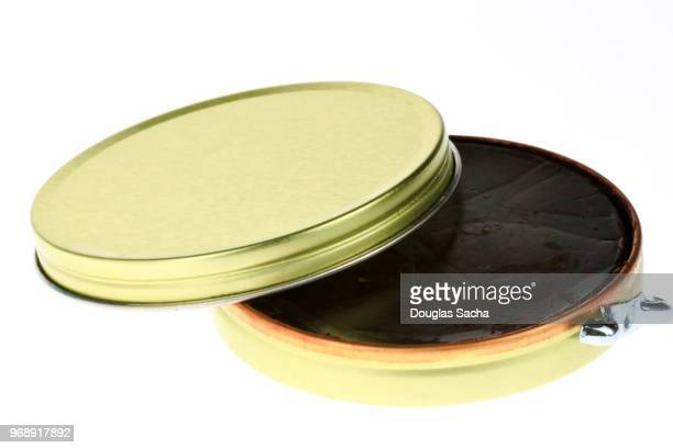 Open container of shoe polish wax for shoe shine