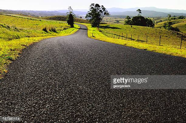 open country road - atherton tableland stock pictures, royalty-free photos & images