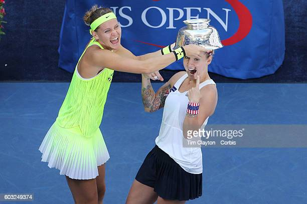 Open - Day 14 Bethanie Mattek-Sands, , of the United States and Lucie Safarova of the Czech Republic joke with the trophy after winning the Women's...