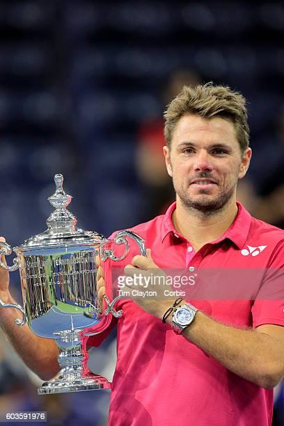 S Open Day 14 Stan Wawrinka of Switzerland celebrates with the trophy after winning the Men's Singles Final against Novak Djokovic of Serbia on...