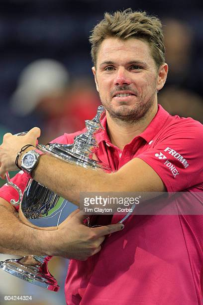 S Open Day 14 Stan Wawrinka of Switzerland celebrates with the trophy after winning the Men's Singles Final against Novak Djokovic of Serbia on...