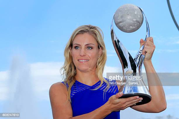 S Open Day 14 US Open women's singles champion Angelique Kerber with the WTA Wold Number One trophy at the Unisphere on day fourteen of the 2016 US...