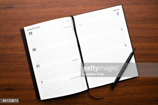 Open Diary New Years Day On Wood Background High-Res Stock ...