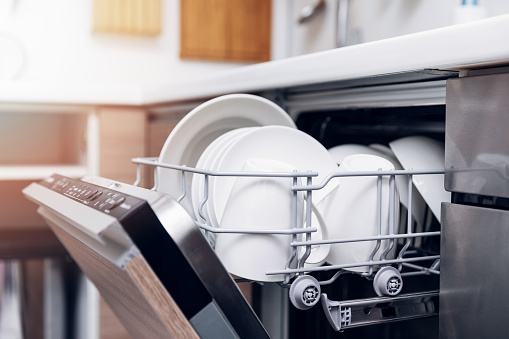 open dishwasher with clean dishes at home kitchen 903658156