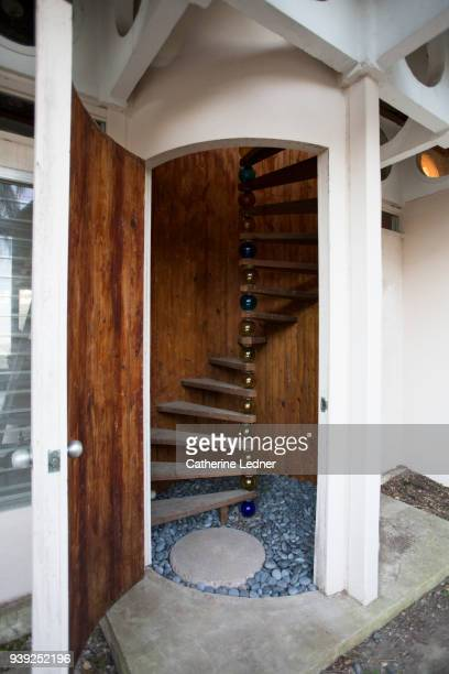 Open Door leading to Spiral Staircase made of wood and glass balls