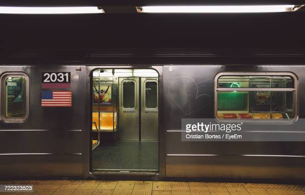 open door of subway train at platform - subway train stock pictures, royalty-free photos & images