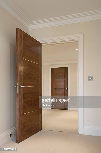 open door to hallway - doorway stock pictures, royalty-free photos & images