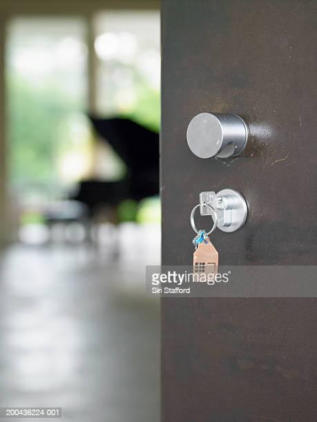Open door to house, keys in lock