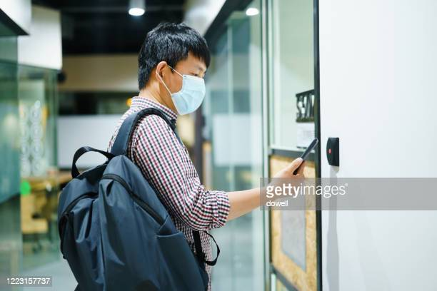 open door with smart phone - open backpack stock pictures, royalty-free photos & images