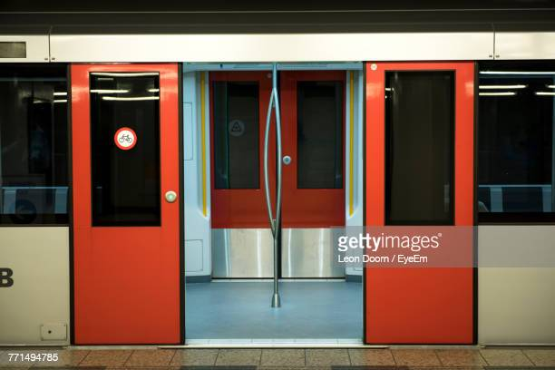 open doors of train at railroad station platform - subway stock pictures, royalty-free photos & images