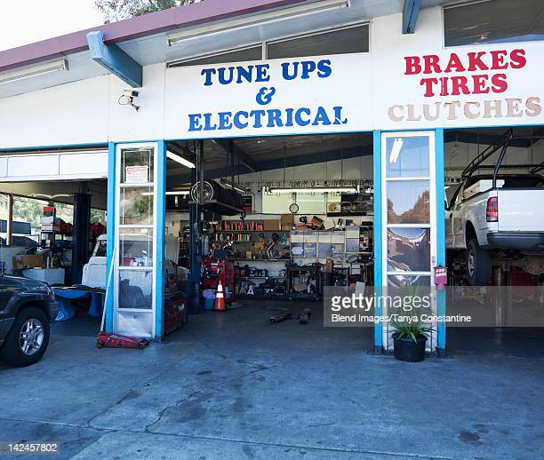 open doorway of auto repair shop - auto repair shop stock pictures, royalty-free photos & images