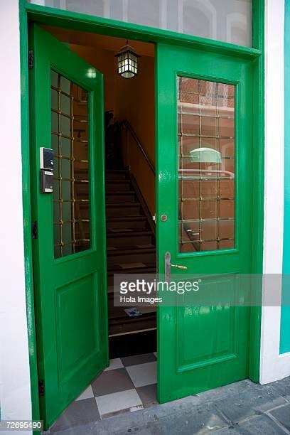 open doorway on sidewalk - ajar stock pictures, royalty-free photos & images