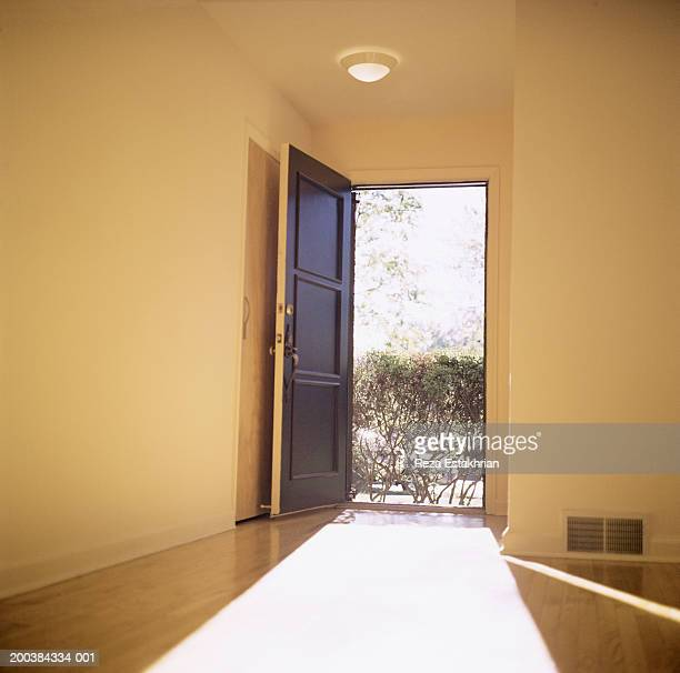 open doorway with light flooding in - front door stock pictures, royalty-free photos & images