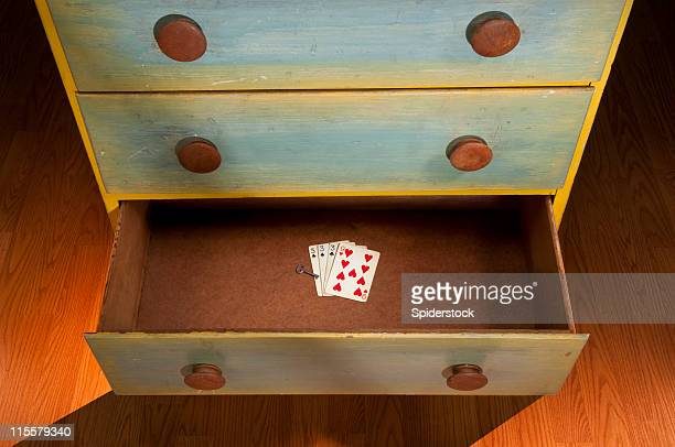 open drawer with playing cards & key - drawer stock pictures, royalty-free photos & images