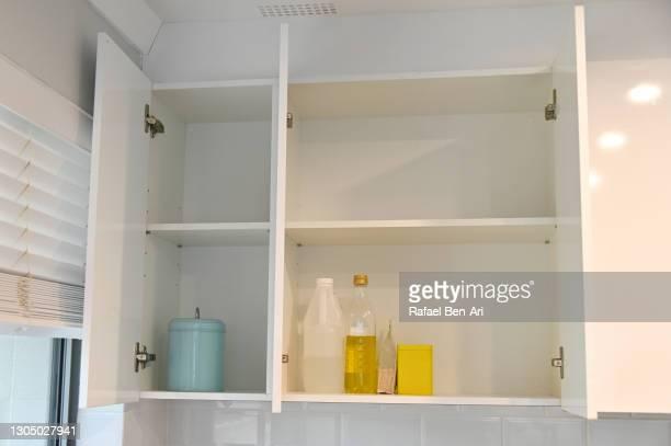 open empty kitchen cabinet - rafael ben ari stockfoto's en -beelden