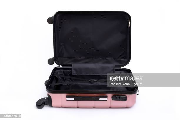 open empty luggage against white background - suitcase stock pictures, royalty-free photos & images