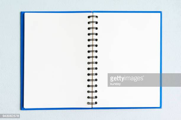 Open empty page of notebook for background.