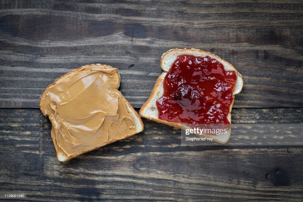 Open face homemade peanut butter and strawberry Jelly sandwich : Stock Photo