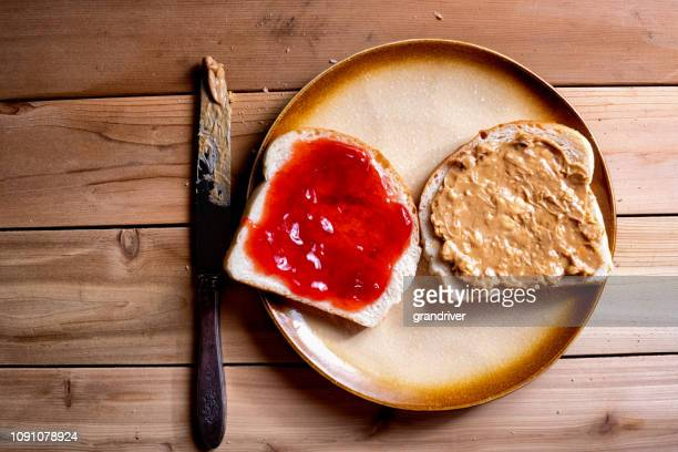 open face peanut butter and jelly sandwich - peanut butter and jelly sandwich stock pictures, royalty-free photos & images