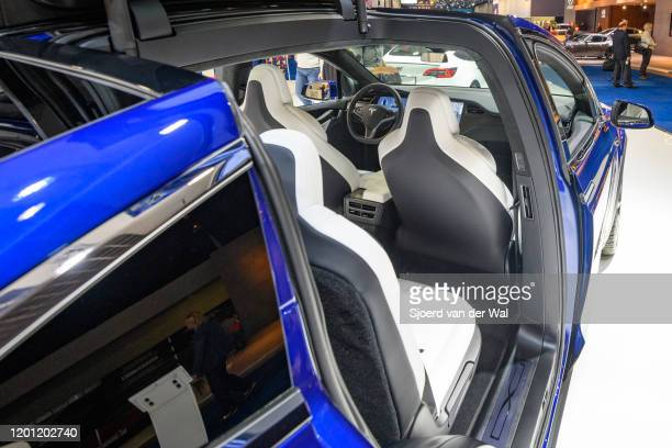 Open Falcon wing doors on a Tesla Model X 90D full electric luxury crossover SUV car on display at Brussels Expo on January 9, 2020 in Brussels,...