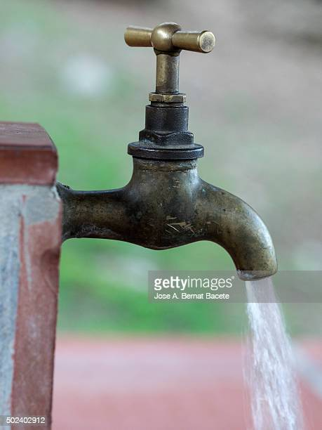 Open faucet with running water