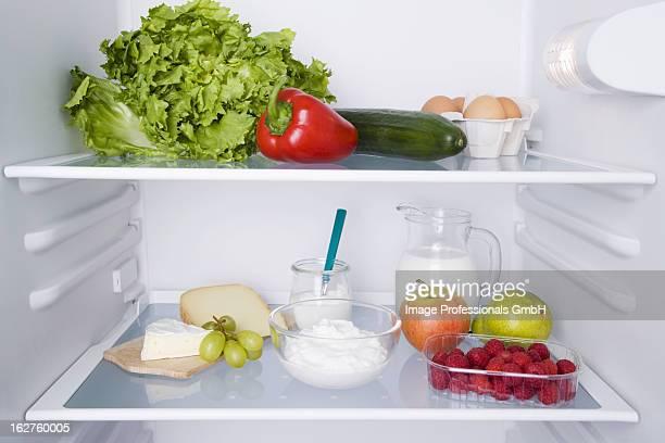 Open fridge with fresh produce
