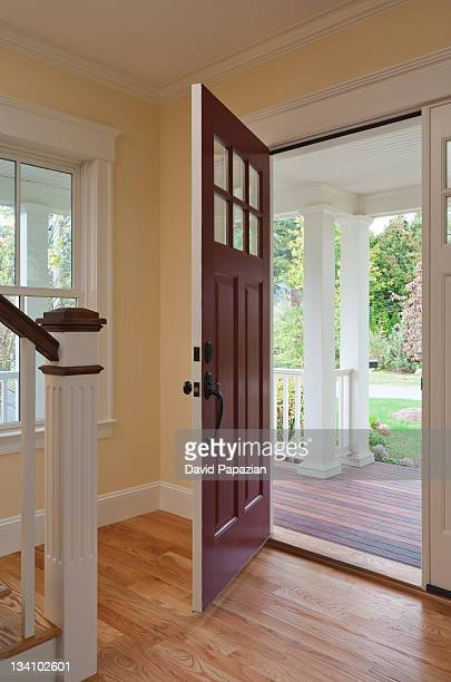 Open front door of home interior