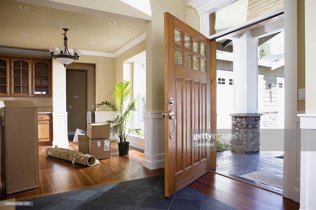 Open Front Door Rolled Up Rug And Cartons On Floor Stock