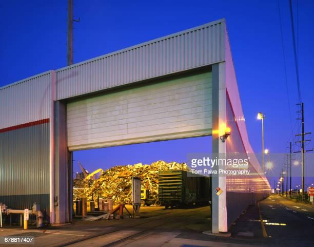 open garage door at junkyard - junkyard stock photos and pictures