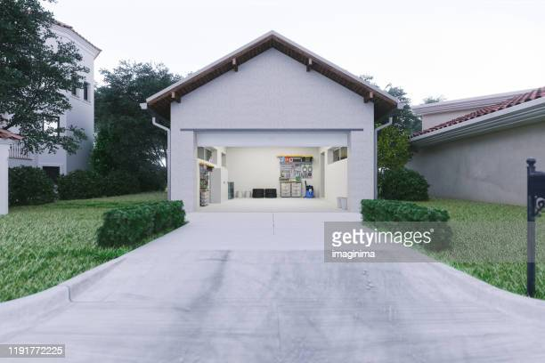 open garage with concrete driveway - garage stock pictures, royalty-free photos & images