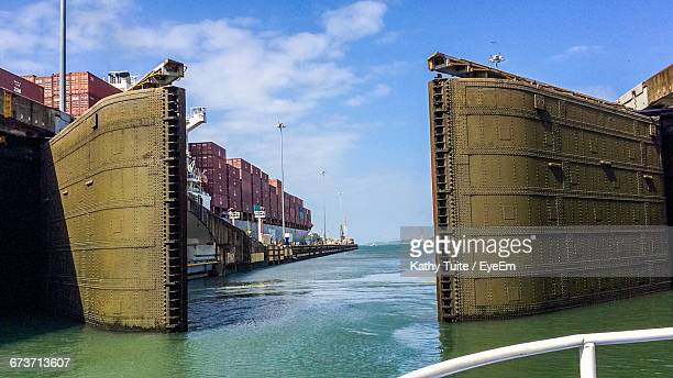 open gates of panama canal against sky - canal stock pictures, royalty-free photos & images