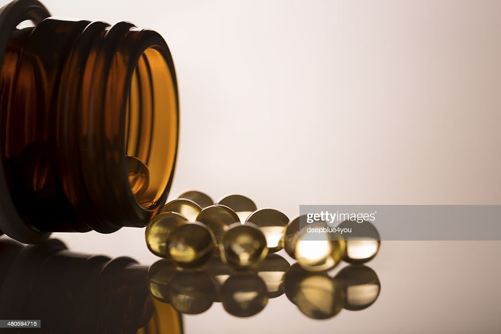 Open glass jar with Gel capsules Vitamin D : Stock Photo