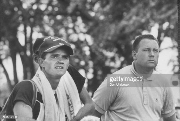 US open golf champ Billy Casper and his caddy watch path of ball during US open tournament