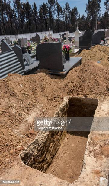 Open graves for the victims of the forest fire at the small village cemetery on June 22 2017 in Vila Facaia Portugal This small village part of...