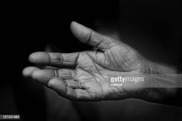 open hand pleading for help - black and white hands stock pictures, royalty-free photos & images