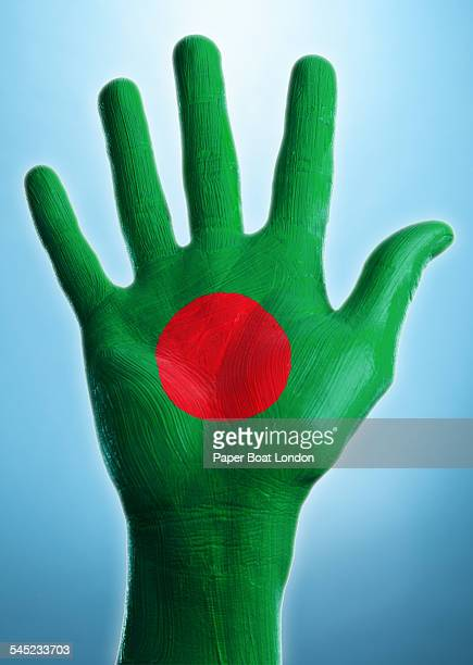 open hand with flag of bangladesh painted on it - bangladesh flag stock photos and pictures