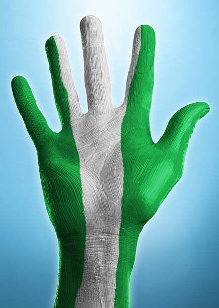 Open hand with flag of Nigeria painted on it