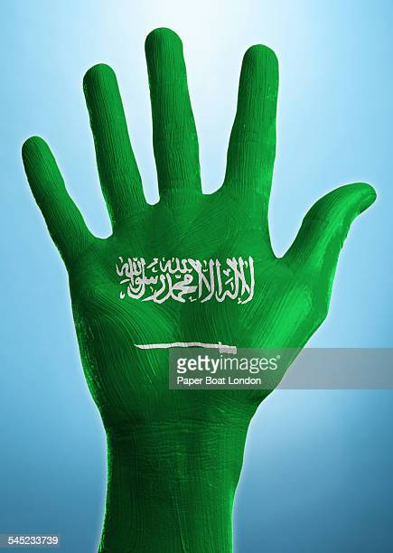 Open hand with flag of Saudi Arabia painted on it