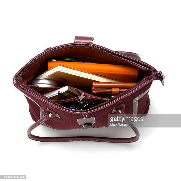 open handbag, overhead view - handtasche stock-fotos und bilder