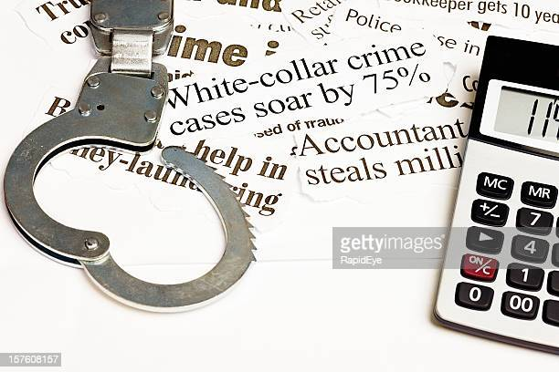 open handcuffs and calculator on white collar crime headlines - ponzi scheme stock pictures, royalty-free photos & images